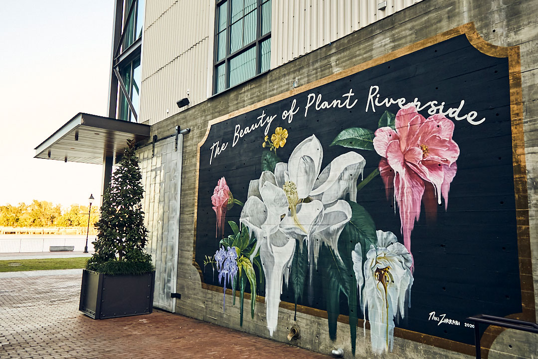 Exterior mural with flowers on the side of a building